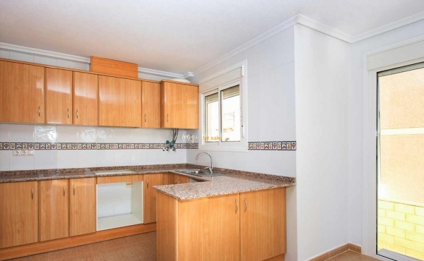Big open plan kitchen with large windows to see out the rear of the villa